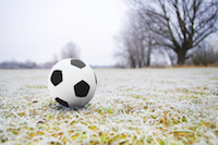 A football on an icy field