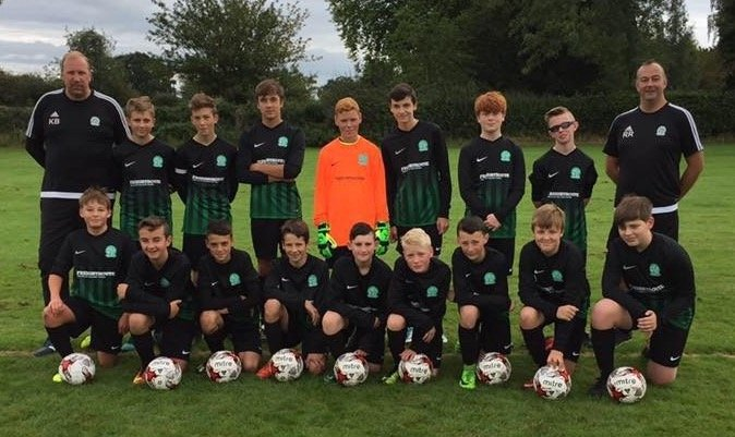 Nova United U14 Black looking smart in their new Freightroute sponsored kit