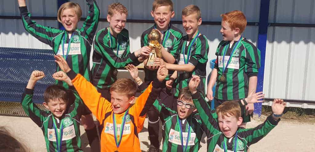 Nova United team celebrate their win with their trophy